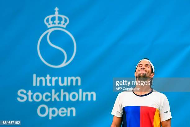 Spain's Fernando Verdasco reacts after a point against Argentina's Juan Martin Del Potro during their semifinal tennis match at the ATP Stockholm...