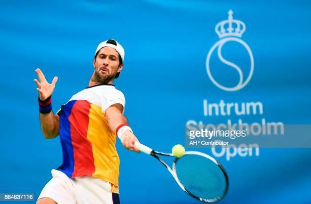 Spain's Fernando Verdasco returns the ball to Argentina's Juan Martin Del Potro during their semifinal tennis match at the ATP Stockholm Open...