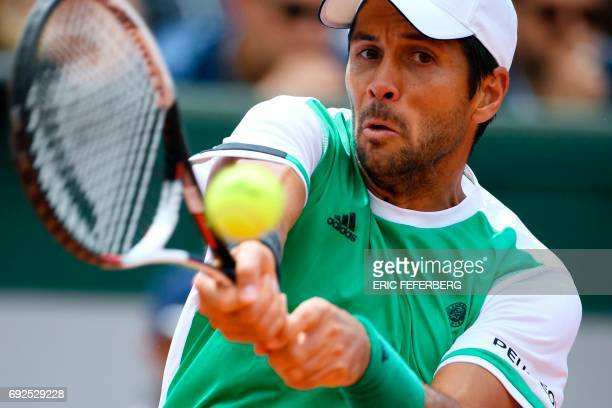 Spain's Fernando Verdasco returns the ball to Japan's Kei Nishikori during their tennis match at the Roland Garros 2017 French Open on June 5 2017 in...