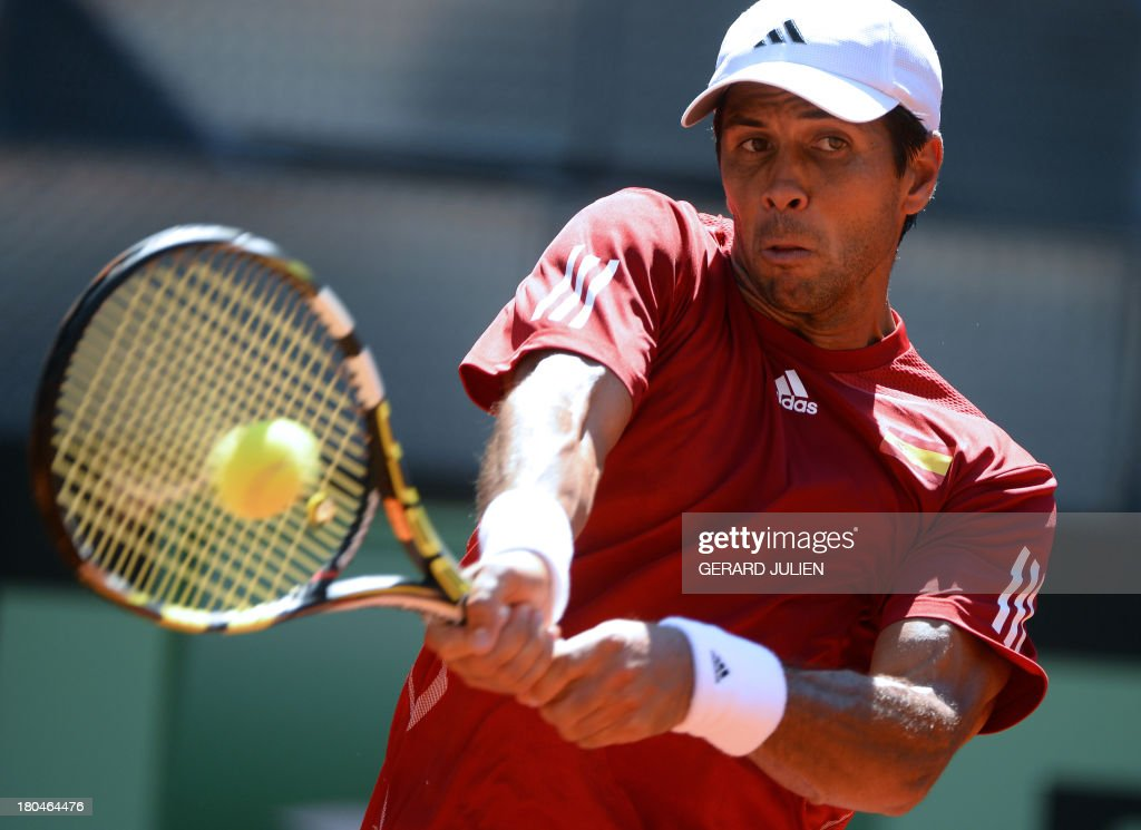 Spain's Fernando Verdasco returns the ball to Ukraine's Alexander Dolgopolov during the 2013 Davis Cup World Group play-off at the Caja Magica sports complex in Madrid on September 13, 2013.