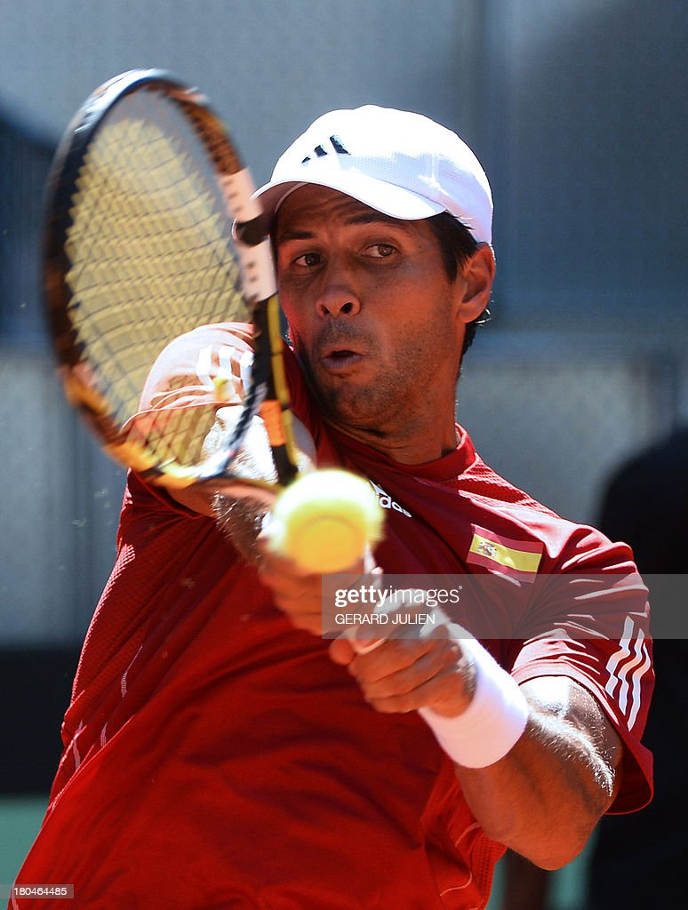 Spain's Fernando Verdasco returns the ball to Ukraine's Alexander Dolgopolov during the Davis Cup World Group play-off 2013 at the Caja Magica sports complex in Madrid on September 13, 2013.