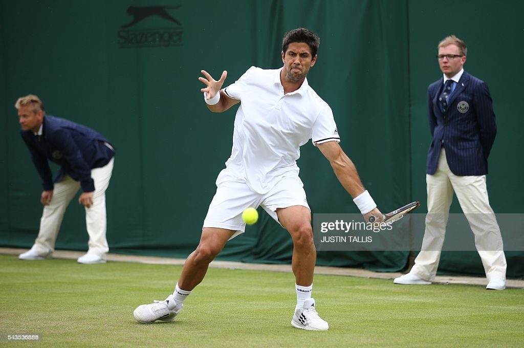 Spain's Fernando Verdasco returns to Australia's Bernard Tomic during their men's singles first round match on the third day of the 2016 Wimbledon Championships at The All England Lawn Tennis Club in Wimbledon, southwest London, on June 29, 2016. / AFP / JUSTIN