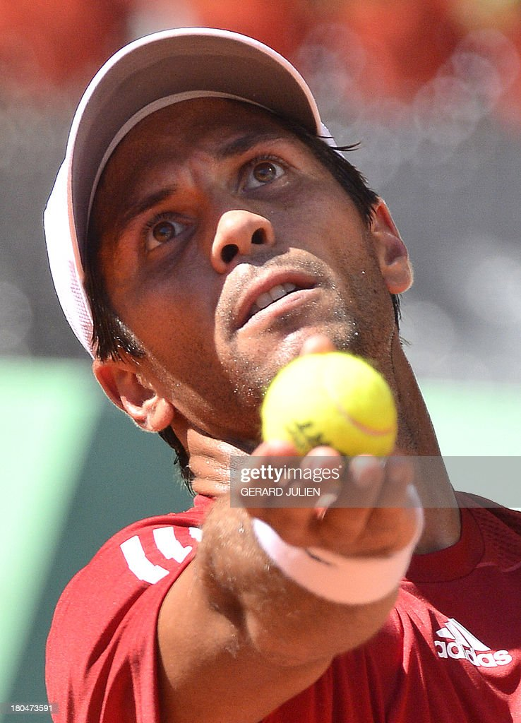 Spain's Fernando Verdasco serves against Ukraine's Alexander Dolgopolov during the World Group Play-offs 2013 at the Caja Magica sports complex in Madrid on September 13, 2013. Winning nations qualify for the World Group in 2014.