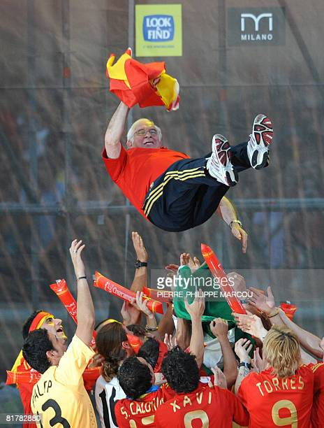 Spain's football coach Luis Aragones is thrown in the air during celebrations in the Plaza Colon in Madrid on June 30 2008 Tens of thousands of...