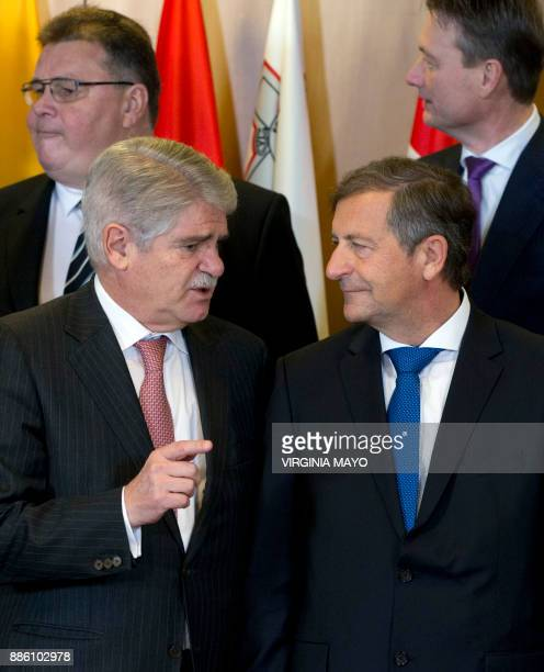 Spain's Foreign Minister Alfonso Dastis talks with Slovenia's Foreign Minister Karl Erjavec as they pose for a group photo with other EU foreign...