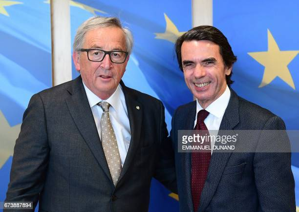 Spain's former Prime Minister Jose Maria Aznar is greeted by European Commission President JeanClaude Juncker at the European Commission in Brussels...