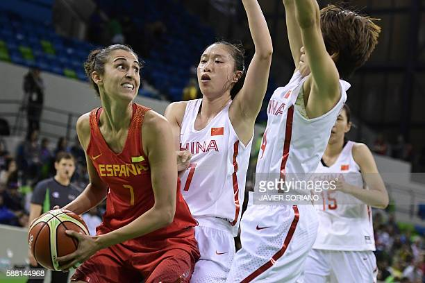 Spain's forward Alba Torrens tries to pass China's small forward Shao Ting during a Women's round Group B basketball match between China and Spain at...