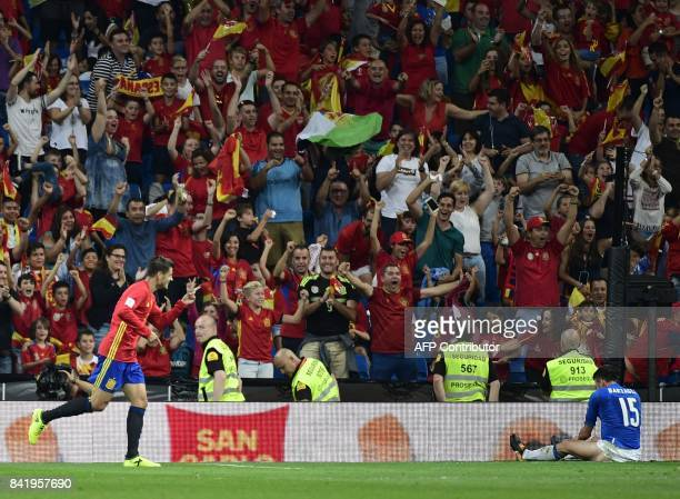 Spain's forward Alvaro Morata celebrates a goal during the World Cup 2018 qualifier football match between Spain and Italy at the Santiago Bernabeu...
