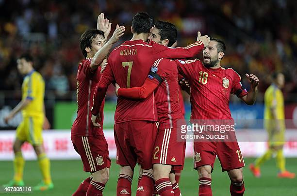 Spain's forward Alvaro Morata celebrates after scoring a goal with Spain's midfielder Isco Spain's forward David Silva and Spain's defender Jordi...