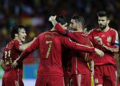 Spain's forward Alvaro Morata celebrates after scoring a goal with Spain's forward David Silva Spain's defender Gerard Pique and Spain's defender...