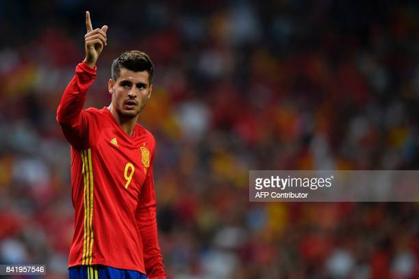 Spain's forward Alvaro Morata celebrates after scoring their third goal during the World Cup 2018 qualifier football match Spain vs Italy at the...