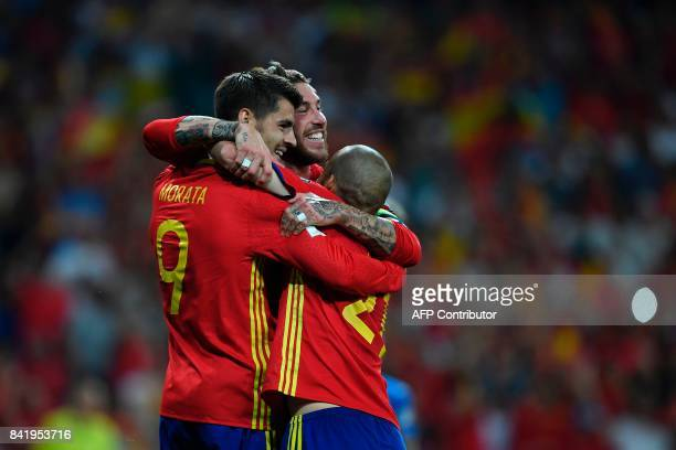 Spain's forward Alvaro Morata celebrates with Spain's defender Sergio Ramos and a teammate after scoring their third goal during the World Cup 2018...