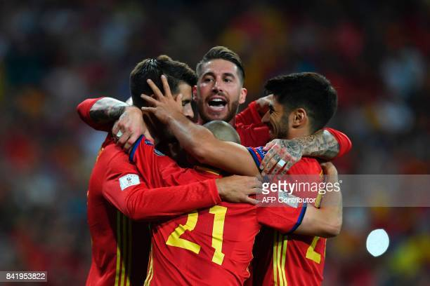 TOPSHOT Spain's forward Alvaro Morata celebrates with Spain's defender Sergio Ramos and teammates after scoring their third goal during the World Cup...