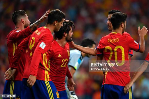 Spain's forward Alvaro Morata celebrates with teammates after scoring their third goal during the World Cup 2018 qualifier football match Spain vs...