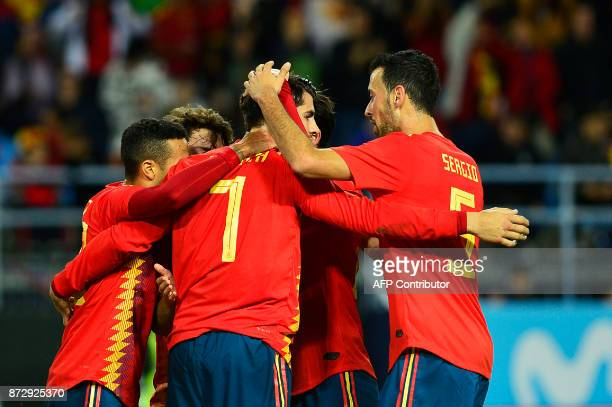 Spain's forward Alvaro Morata celebrates with teammates after scoring a goal during the international friendly football match Spain against Costa...