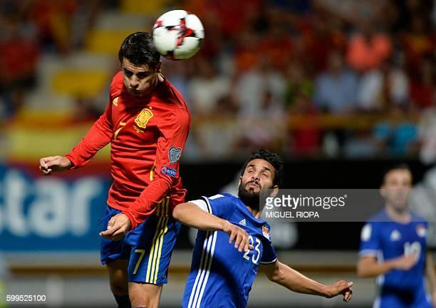 Spain's forward Alvaro Morata heads the ball with Liechtenstein's midfielder Michele Polverino during the WC 2018 football qualification match...