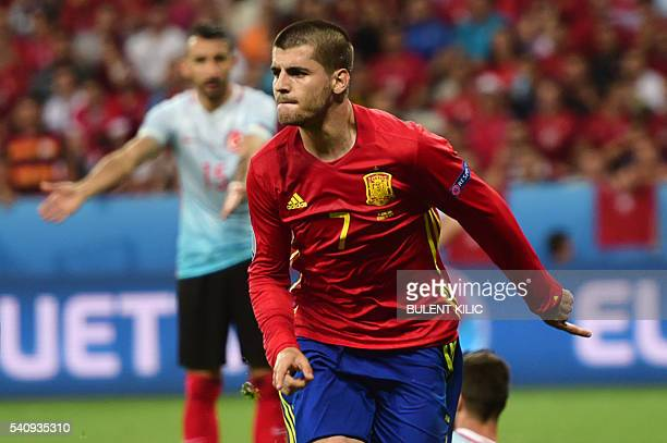 Spain's forward Alvaro Morata runs to celebrate his goal during the Euro 2016 group D football match between Spain and Turkey at the Allianz Riviera...