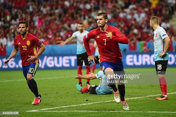 TOPSHOT Spain's forward Alvaro Morata runs to celebrate his goal during the Euro 2016 group D football match between Spain and Turkey at the Allianz...