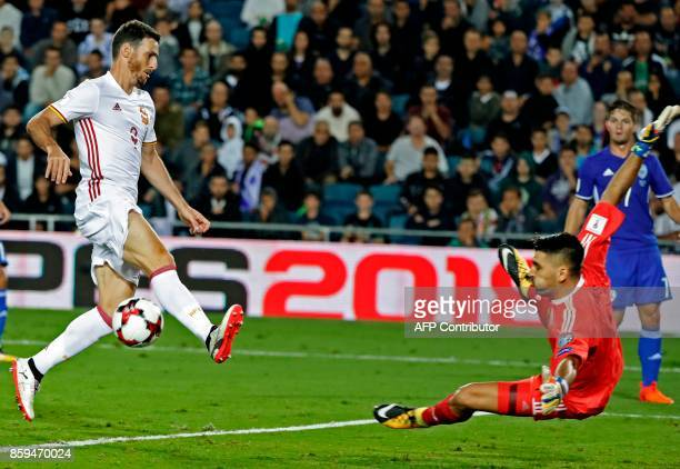 Spain's forward Artiz Aduriz vies for the ball with Israel's goalkeeper Ariel Harosh during the Russia 2018 FIFA World Cup European Group G...