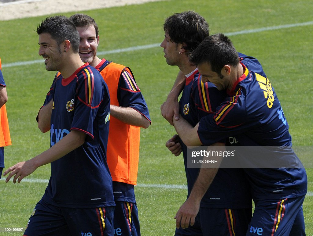 Spain's forward David Villa, Spain's midfielder Juan Mata, Spain's defender Joan Capdevila and Spain's defender Carlos Marchena take part in a training session of the Spanish football team on May 25, 2010, at the Sports City of Las Rozas, near Madrid. Spain, among the favourites for the World Cup, which runs from June 11-July 11, face Switzerland, Honduras and Chile in Group H of the opening round.