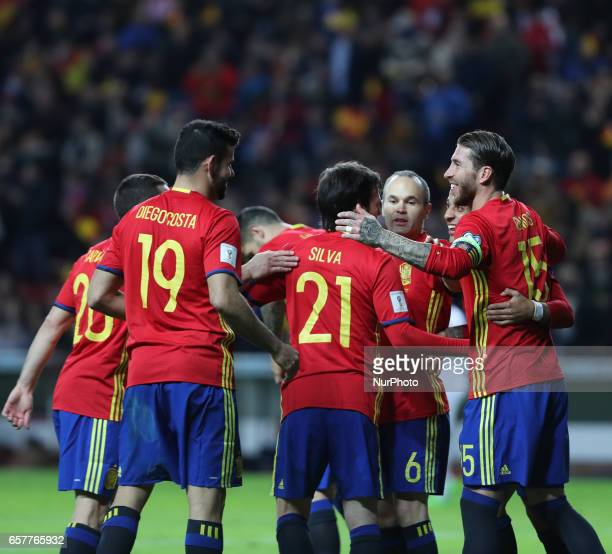 Spain's forward Diego Costa and David Silva are congratulated by teammate defender Sergio Ramos after scoring a goal during the WC 2018 group G...