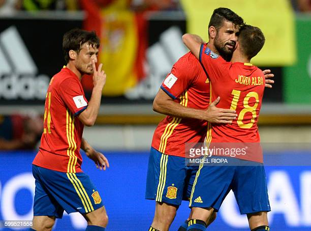 Spain's forward Diego Costa celebrates a goal with teammates during the WC 2018 football qualification match between Spain and Liechtenstein at the...