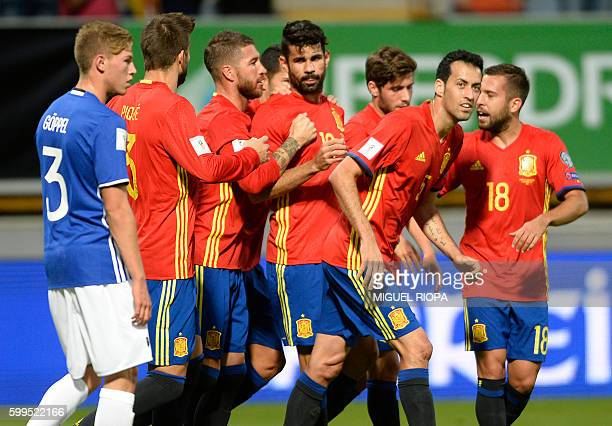 Spain's forward Diego Costa celebrates with teammates after scoring a goal during the WC 2018 football qualification match between Spain and...