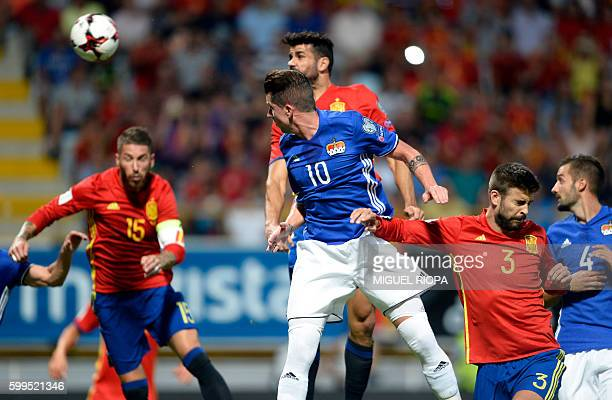 Spain's forward Diego Costa heads the ball to score a goal during the WC 2018 football qualification match between Spain and Liechtenstein at the...