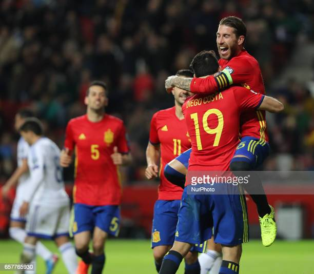 Spain's forward Diego Costa is congratulated by teammate defender Sergio Ramos after scoring a goal during the WC 2018 group G football qualifing...