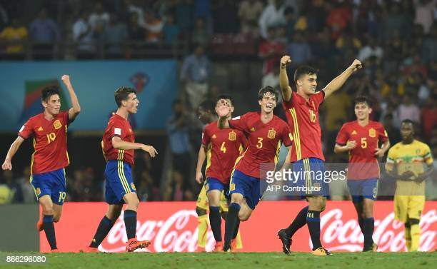 Spain's forward Diego Pampin Juan Miranda Carlos Beitia and teammates celebrate after winning their semifinal football match against Mali during the...