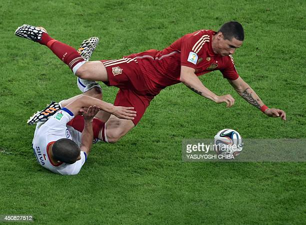 Spain's forward Fernando Torres and Chile's midfielder Francisco Silva vie for the ball during a Group B football match between Spain and Chile in...