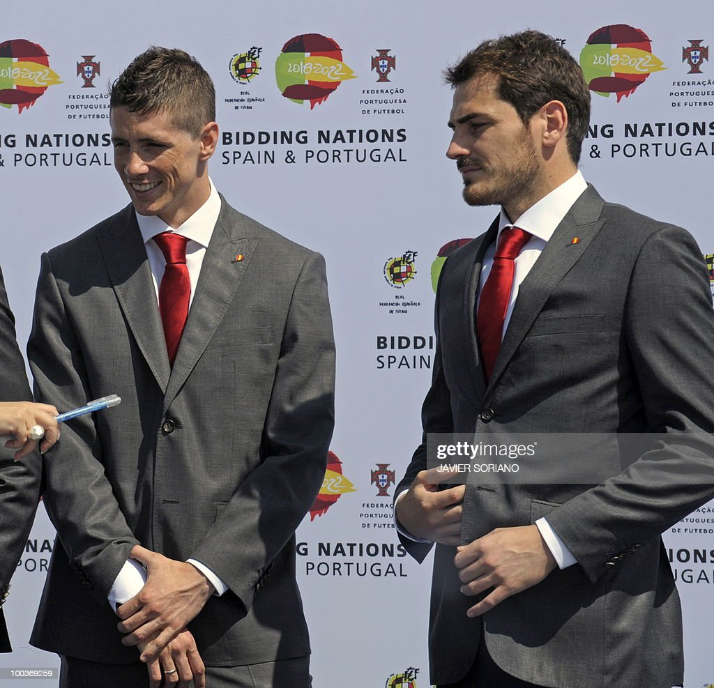 Spain's forward Fernando Torres (L) and goalkeeper Iker Casillas gather for a group picture during the inauguration of RFEF museum on May 24, 2010 at the Sports City of Las Rozas, near Madrid. Spain, among the favourites for the World Cup, which runs from June 11-July 11, face Switzerland, Honduras and Chile in Group H of the opening round.