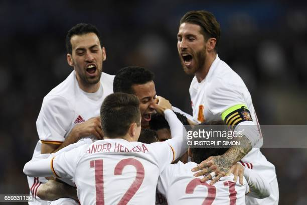 TOPSHOT Spain's forward Gerard Deulofeu celebrates scoring a goal with teammates during the friendly football match France vs Spain on March 28 2017...