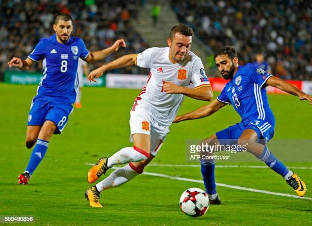 Spain's forward Iago Aspas vies for the ball with Israel's defender Ofir Davidadza during the Russia 2018 FIFA World Cup European Group G qualifying...