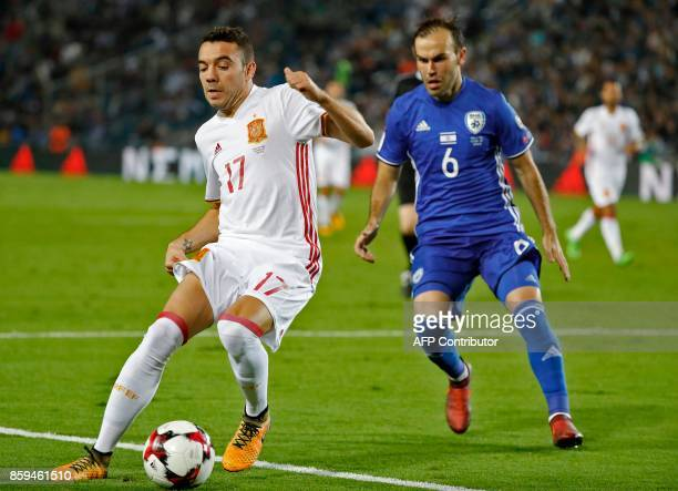 Spain's forward Iago Aspas vies for the ball with Israel's midfielder Bibras Natcho during the Russia 2018 FIFA World Cup European Group G qualifying...