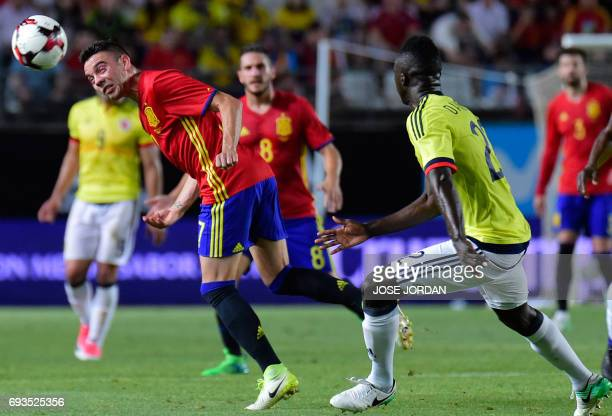 Spain's forward Iago Aspas vies with Colombia's forward Davinson Sanchez during the friendly international football match Spain vs Colombia at the...