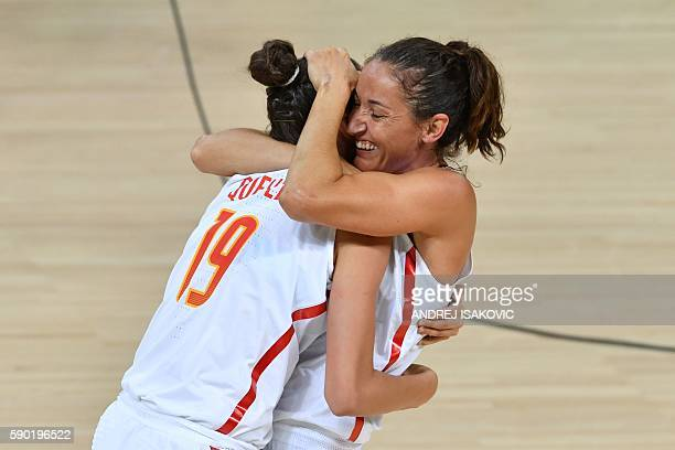 Spain's forward Laura Quevedo and Spain's point guard Laia Palau celebrate after defeating Turkey during a Women's quarterfinal basketball match...