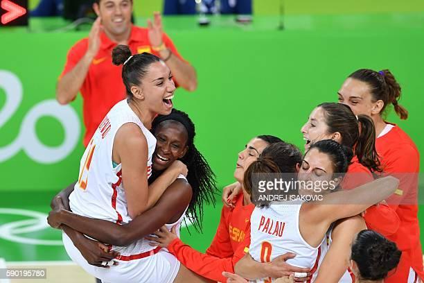 Spain's forward Laura Quevedo Spain's power forward Astou Ndour and Spain's point guard Laia Palau and Spain's point guard Silvia Dominguez celebrate...