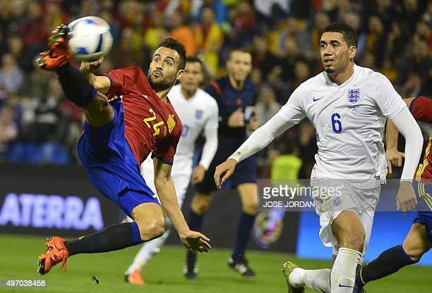 Spain's forward Mario kisck to score past England's defender Chris Smalling during the friendly football match Spain vs England at the Jose Rico...