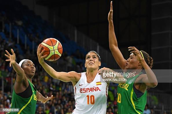 TOPSHOT Spain's forward Marta Xargay goes to the basket past Senegal's power forward Astou Traore during a Women's round Group B basketball match...