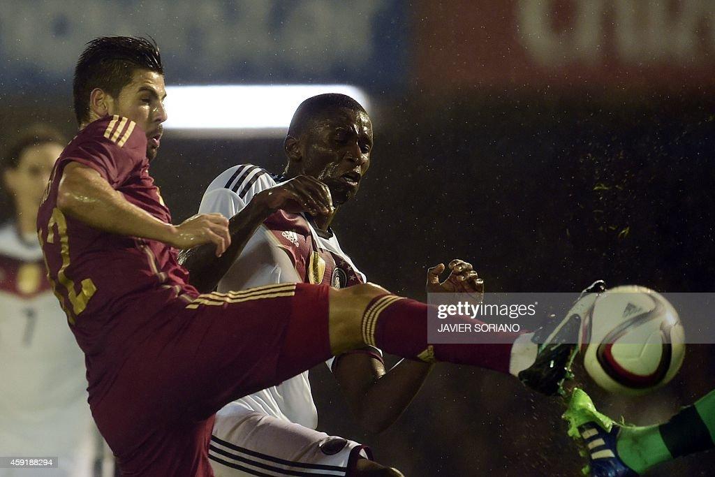 Spain's forward Nolito vies with Germany's defender Antonio Rudiger during a friendly football match Spain vs Germany at the Balaidos stadium in Vigo...