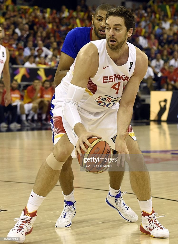 Spain's forward Pau Gasol vies with France's forward Boris Diaw during the 2014 FIBA World basketball championships group A match Spain vs France at...