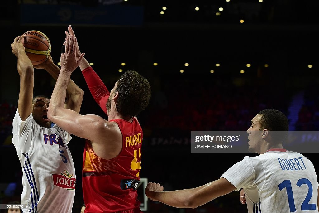 Spain's forward Pau Gasol vies with France's forward Nicolas Batum and France's centre Rudy Gobert during the 2014 FIBA World basketball...