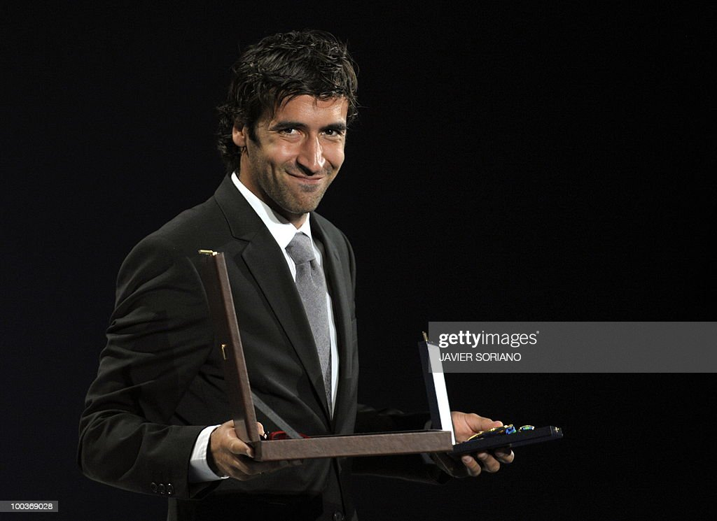 Spain's forward Raul Gonzalez holds his Gold Medal for Sports Merit after being awarded the medal during the inauguration of RFEF museum on May 24, 2010 at the Sports City of Las Rozas, near Madrid. Spain, among the favourites for the World Cup, which runs from June 11-July 11, face Switzerland, Honduras and Chile in Group H of the opening round.
