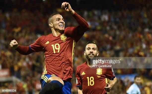 Spain's forward Rodrigo Moreno celebrates a goal beside Spain's defender Jordi Alba during the World Cup 2018 qualifier football match Spain vs...