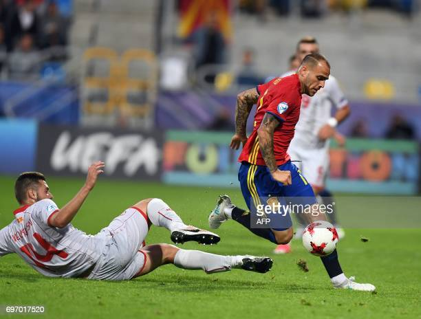 Spain's forward Sandro Ramirez is tackled by Macedonia's defender Darko Velkoski during the UEFA U21 European Championship Group B football match...