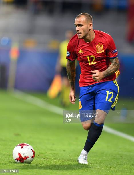 Spain's forward Sandro Ramirez runs with the ball during the UEFA U21 European Championship Group B football match Spain v FYR Macedonia on June 17...