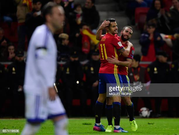 Spain's forward Vitolo is congratulated by teammate defender Dani Carvajal after scoring a goal during the WC 2018 group G football qualifing match...