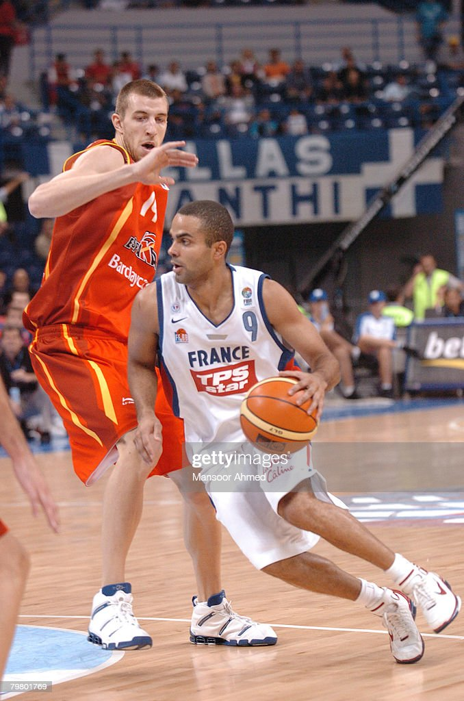 Spain's Fran Vazquez has no answer for the quickness of France's Tony Parker has he speeds past him towards the basket during the Bronze medal match of the European Basketball Championships at the Belgrade Arena, Belgrade, Serbia & Montenegro, 24th September 2005.