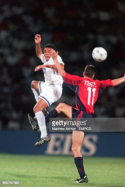 Spain's Francisco Javier Yeste and Julio Leon of Honduras battle for an aerial ball